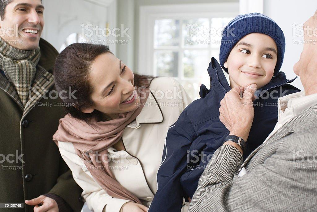Boy visiting grandfather foto de stock royalty-free