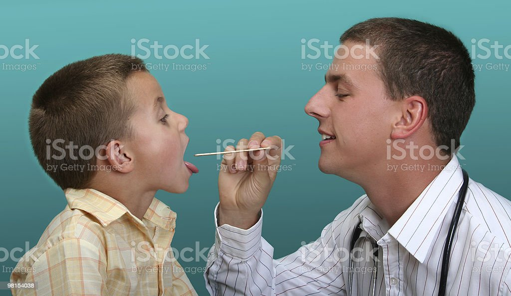 Boy visiting the doctor royalty-free stock photo