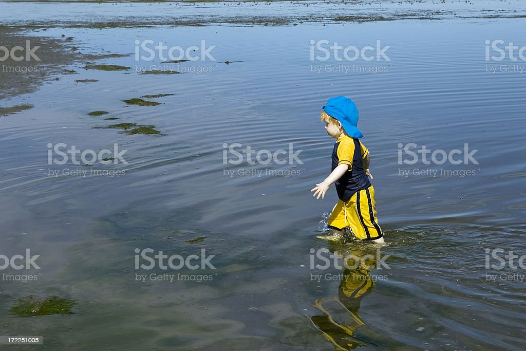 Boy walking in water royalty-free stock photo