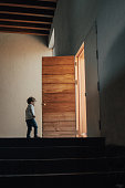 Boy walking through the door
