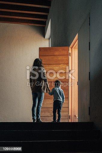 istock Boy walking through the door 1094448968
