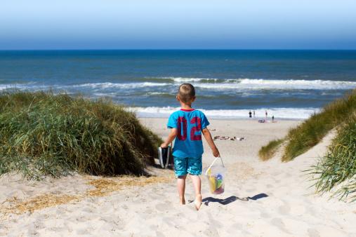 Boy walking towards beach