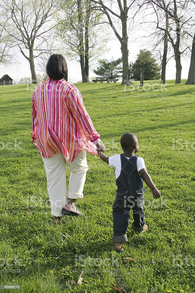Boy walking with mom royalty-free stock photo