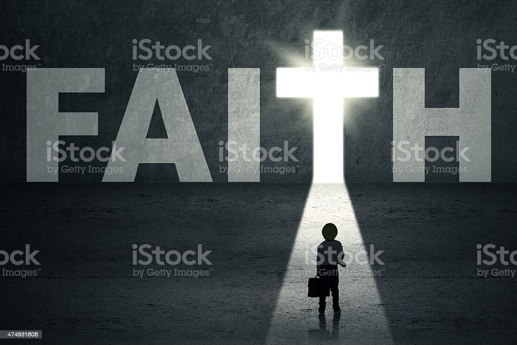 Boy walks toward faith door stock photo