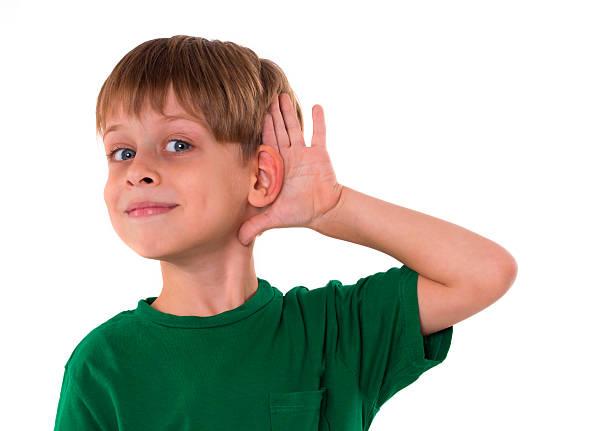 boy wants to hear something stock photo