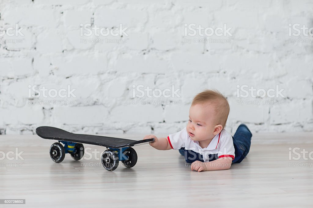 boy was crawling to the skateboard stock photo