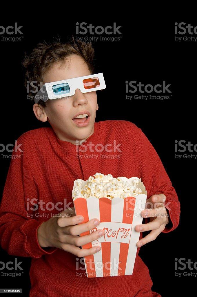 Boy Watching a Movie stock photo