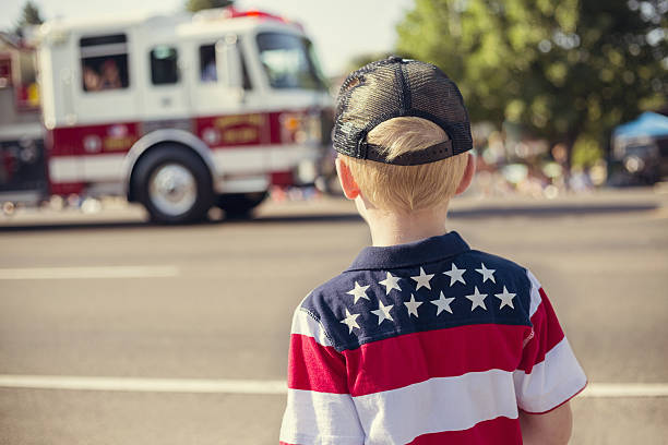 Boy watching an Independence Day Parade stock photo