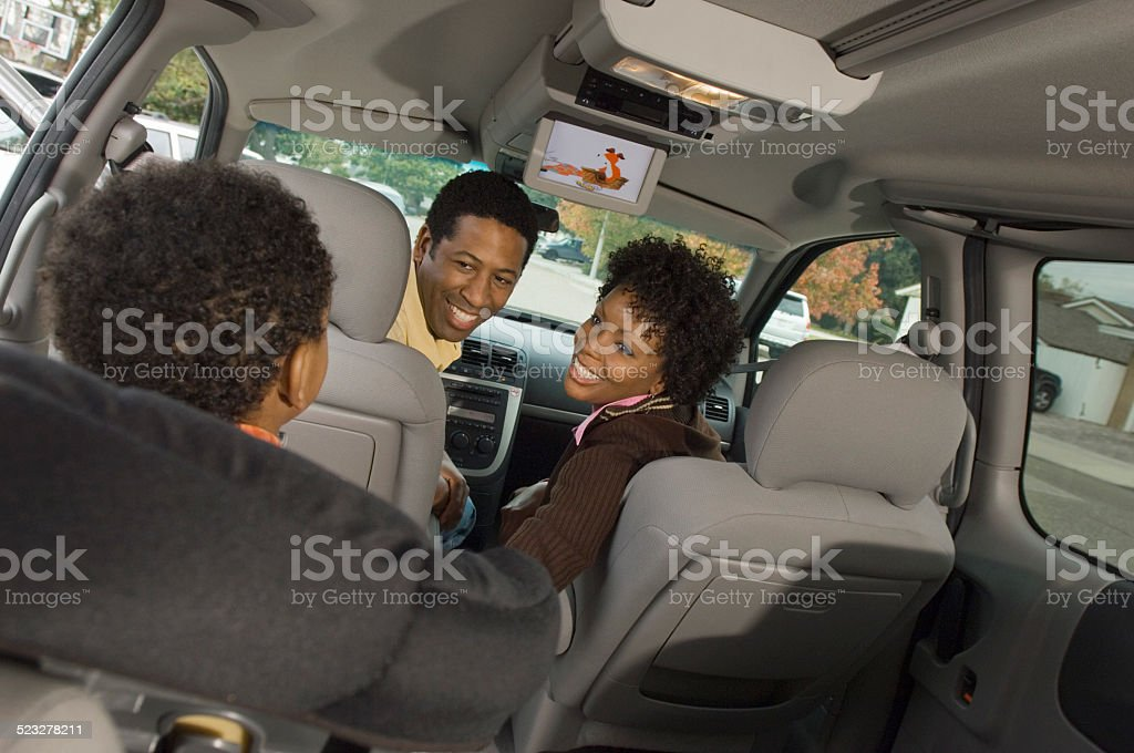 Boy Watching DVD in Minivan stock photo