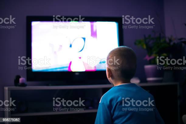 Boy watching television in dark picture id938275082?b=1&k=6&m=938275082&s=612x612&h=qph7amwvf9rr htkmum7dsgvuplc6nsnzyy0unkinga=
