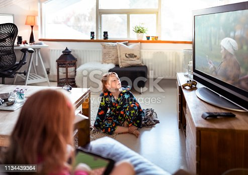 istock Boy watching TV while relaxing at home 1134439364