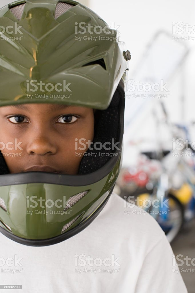 Boy wearing a bicycle helmet stock photo