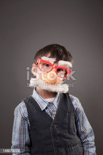 istock Boy wearing a funny face disguise 145073229