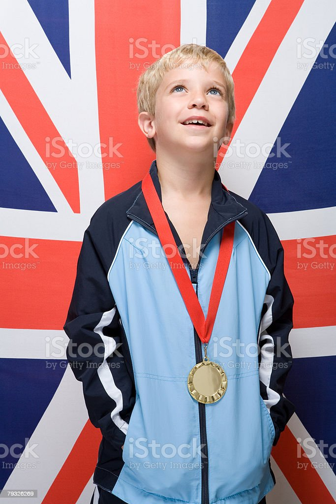 Boy wearing a medal royalty-free stock photo