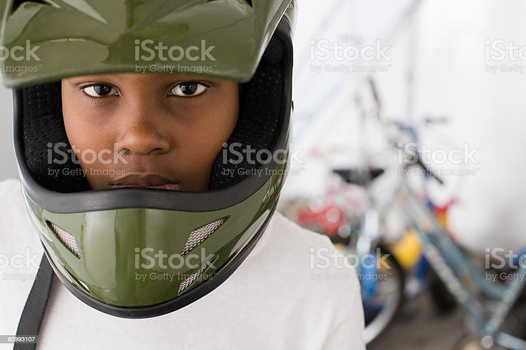 Boy wearing bicycle helmet stock photo