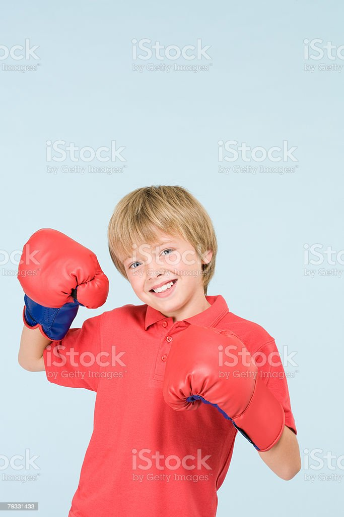 Boy wearing boxing gloves royalty-free stock photo