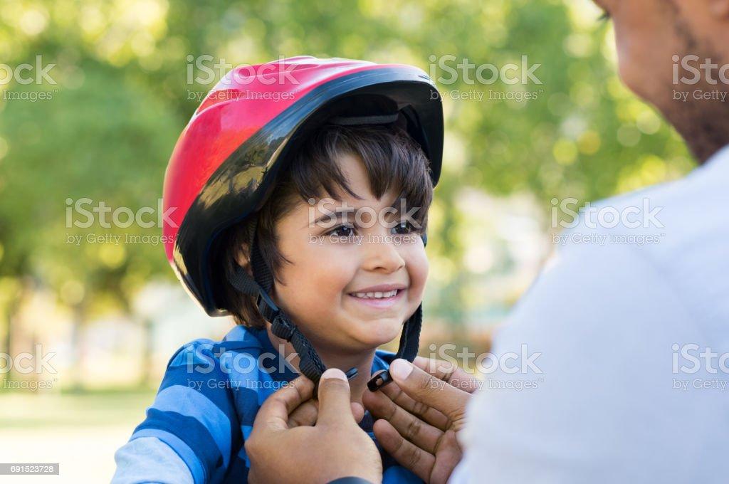 Boy wearing cycle helmet stock photo