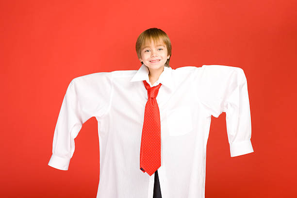 Boy wearing dads clothes stock photo