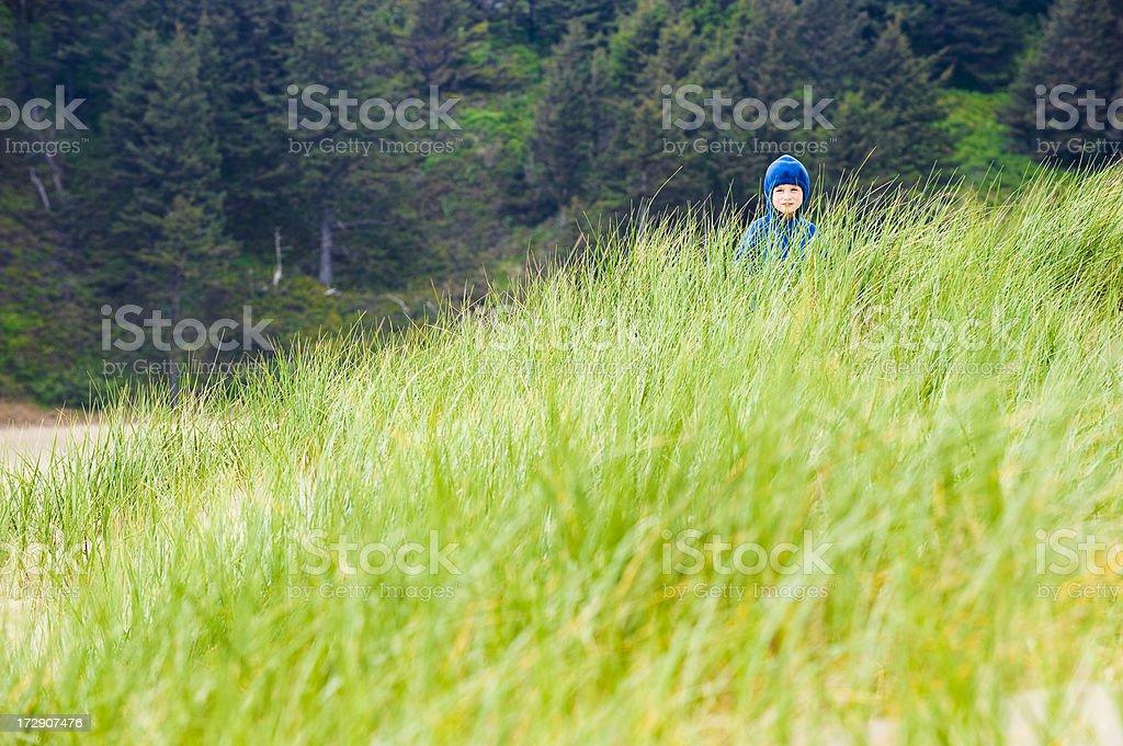 Boy wearing jacket on the ocean shore royalty-free stock photo