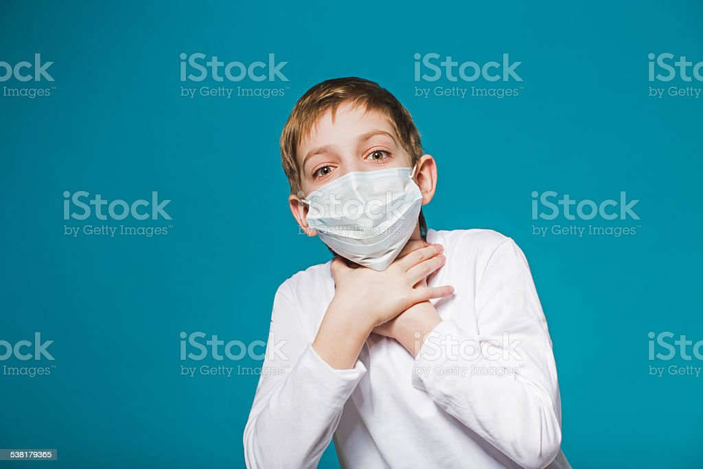 Boy wearing protection mask is short of breath stock photo