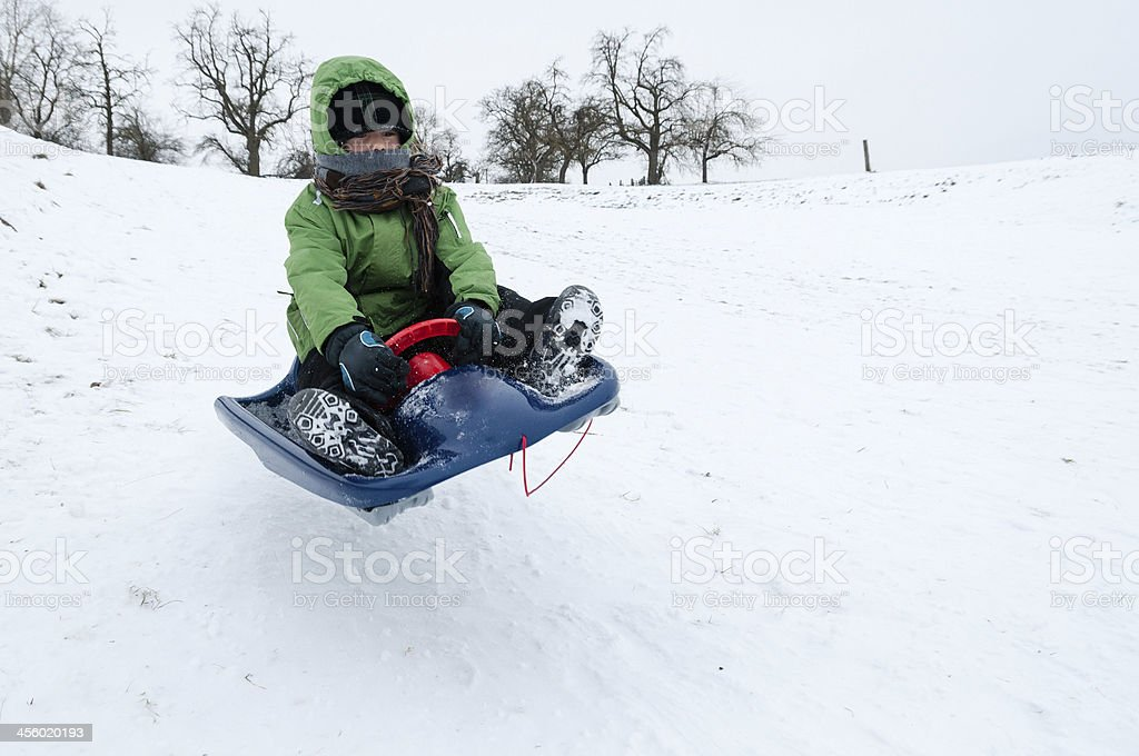 Boy, when bobsleigh. Flying in the air.  Winter, Southern German stock photo