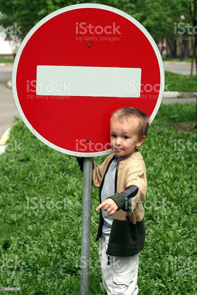 boy whith traffic sign stock photo