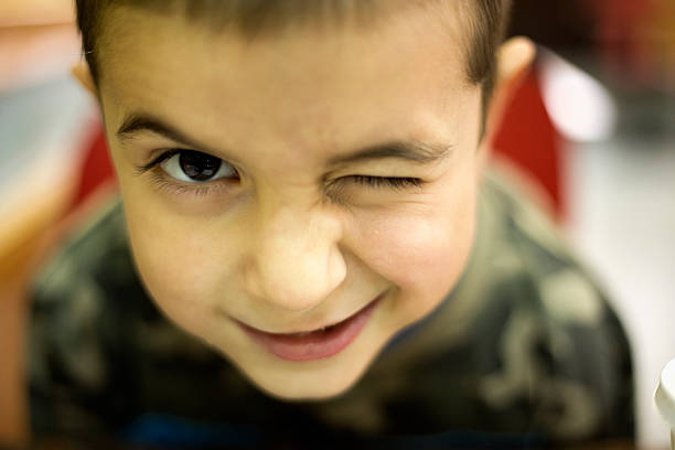 boy winking - blinking stock pictures, royalty-free photos & images