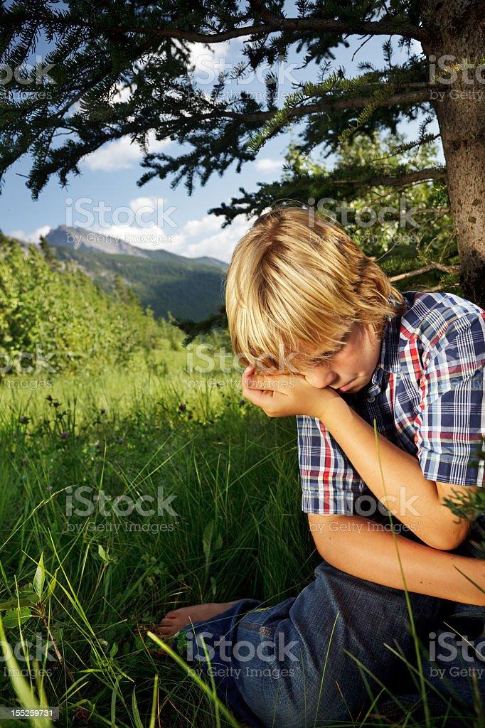 Boy wipes away a tear royalty-free stock photo