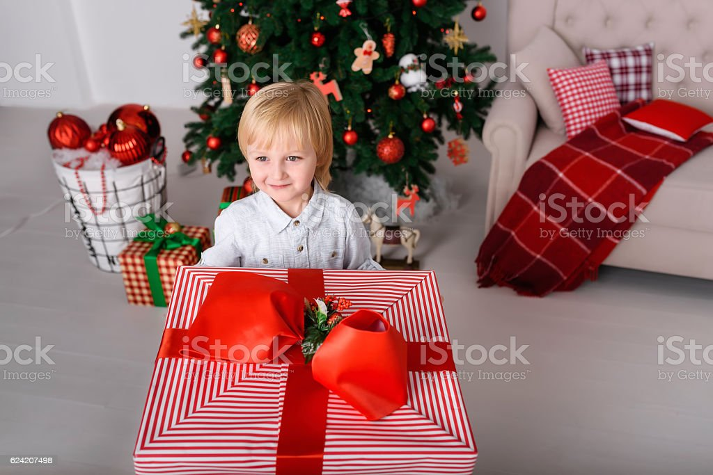 Boy with a big Christmas gift stock photo