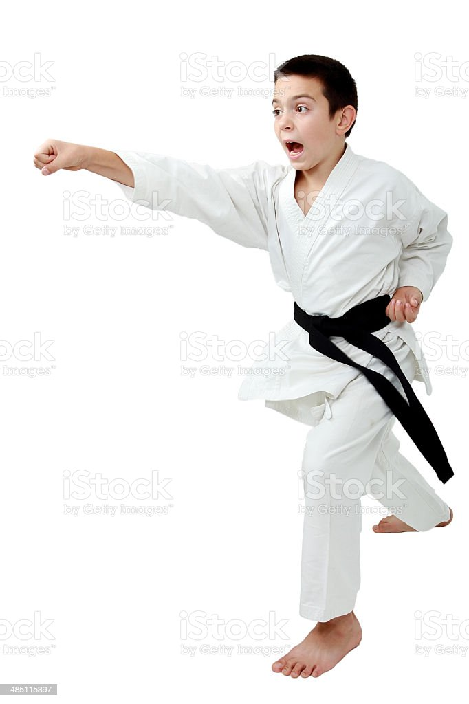 Boy with a black belt beat a punch arm stock photo