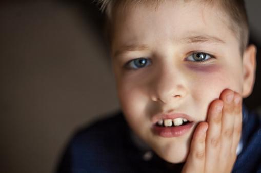 istock A boy with a black eye 954812012