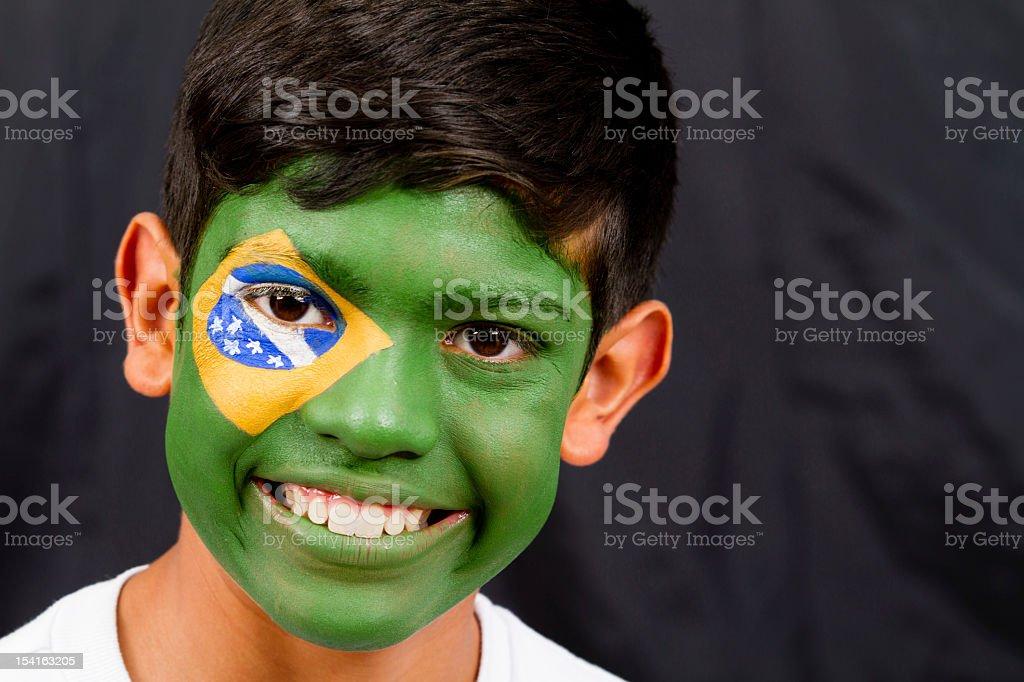 Boy with a Brazilian flag royalty-free stock photo