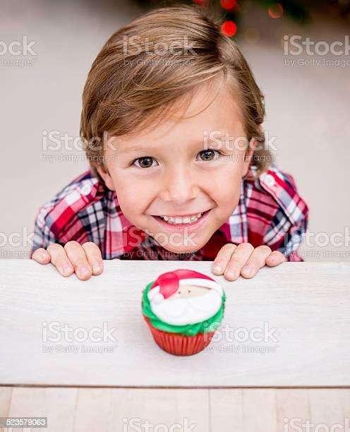Boy with a christmas cupcake picture id523579063?b=1&k=6&m=523579063&s=612x612&h=yklbml2h5 ttk526qksatj0uyvyeepcg6tow3qcqhva=