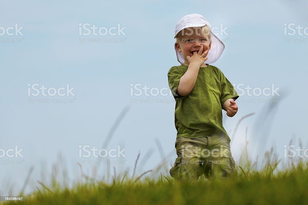 Boy with a finger in his mouth. stock photo