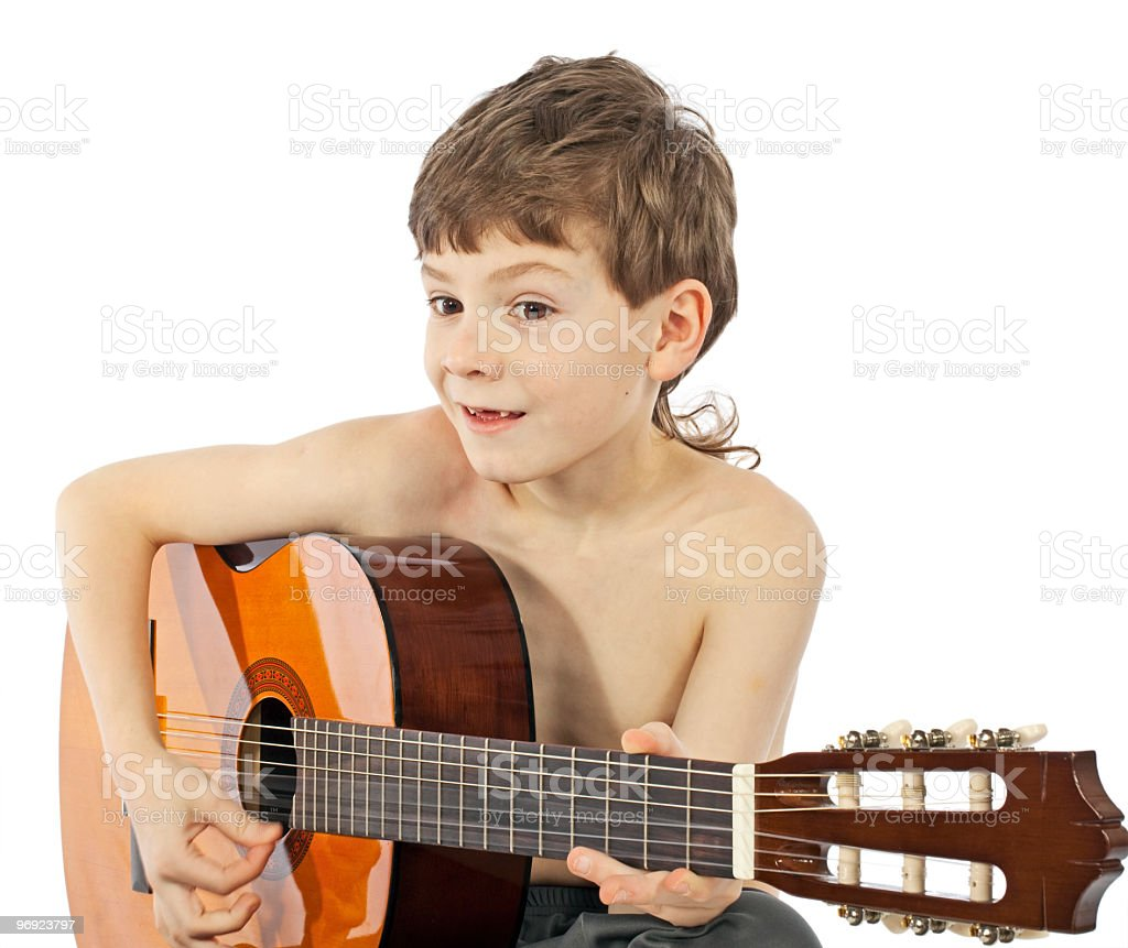 Boy with a guitar smiling royalty-free stock photo