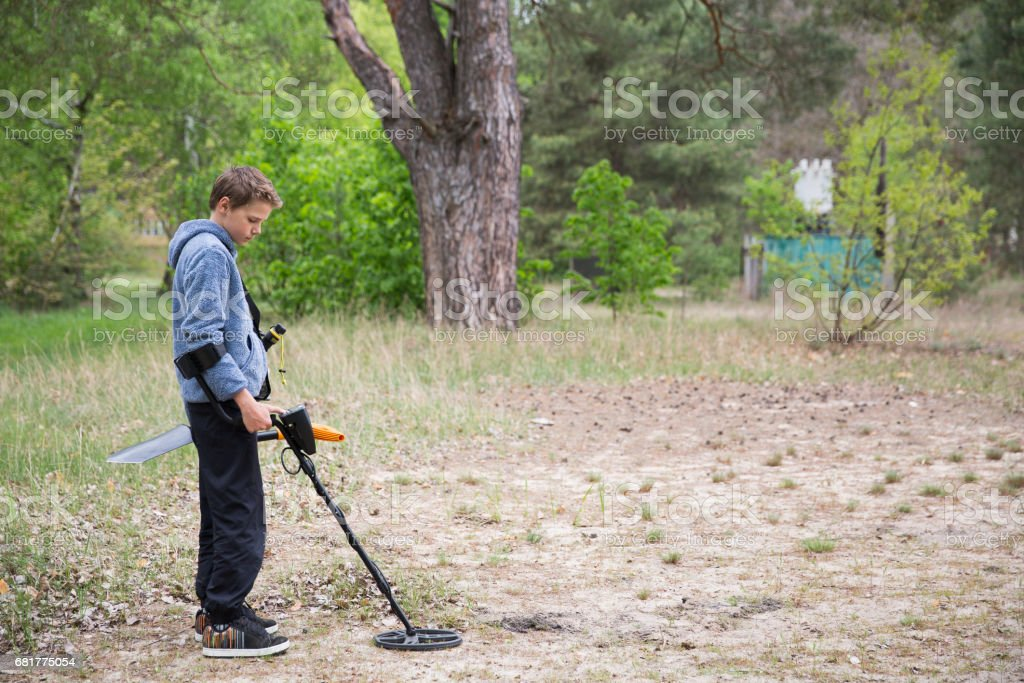 boy with a metal detector stock photo