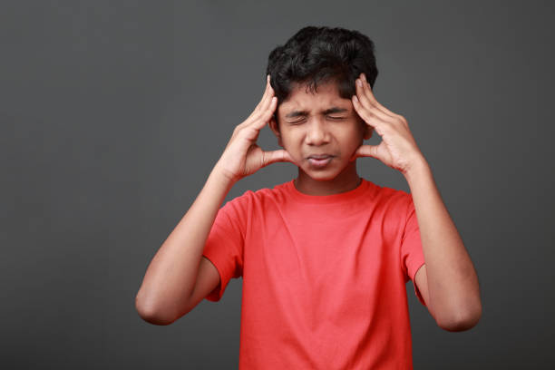 Boy with a painful face expression stock photo