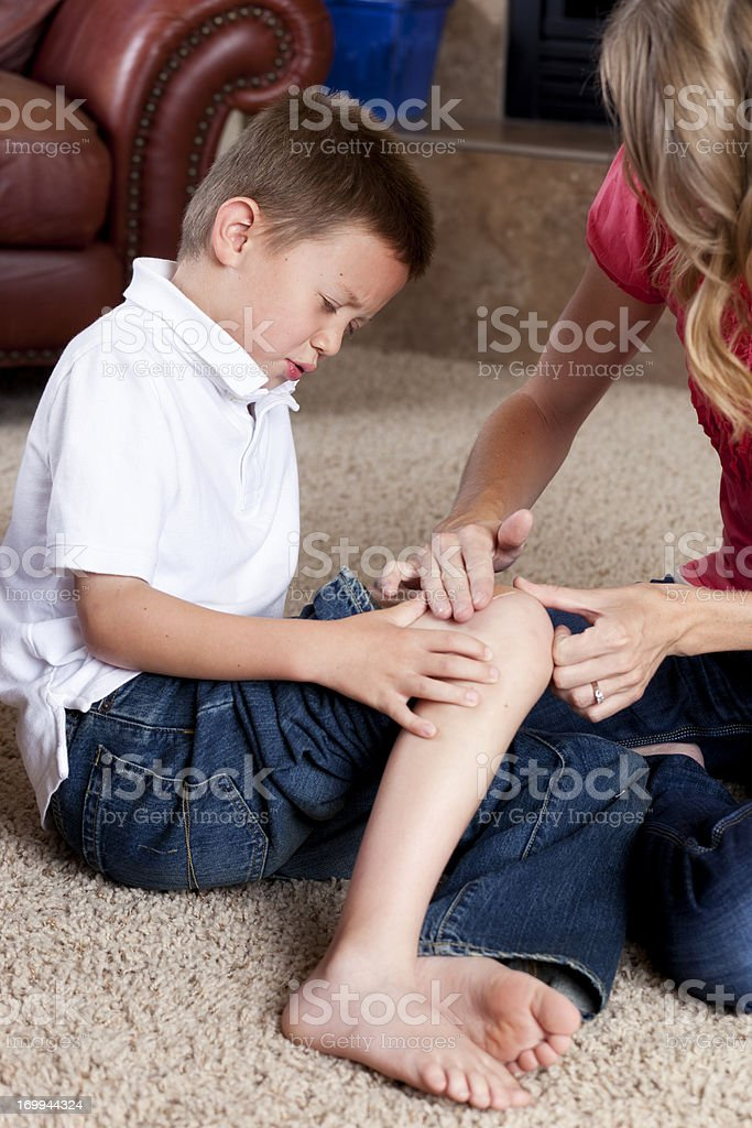 Boy with a Scraped Knee stock photo