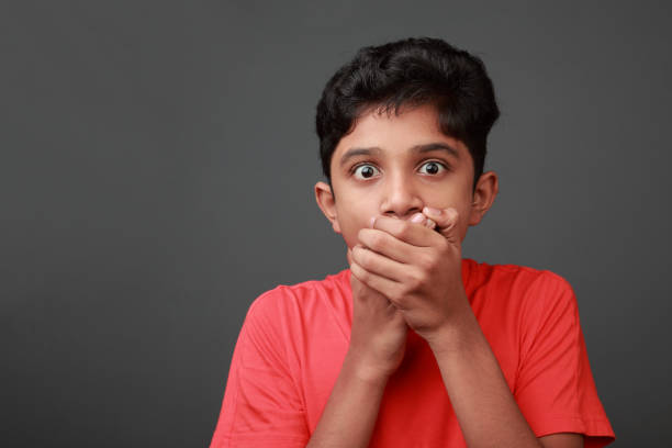Boy with a shocked face expression stock photo