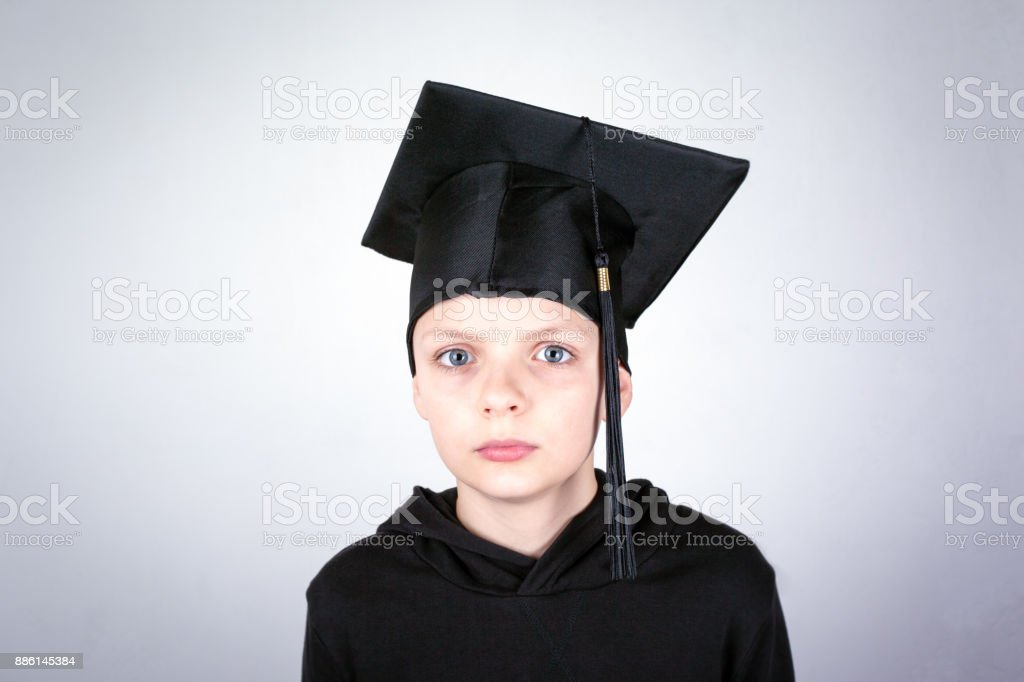 Boy with a student hat. Knowledge, education and a successful career background stock photo