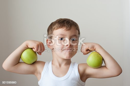 istock boy with apples show biceps 501595660