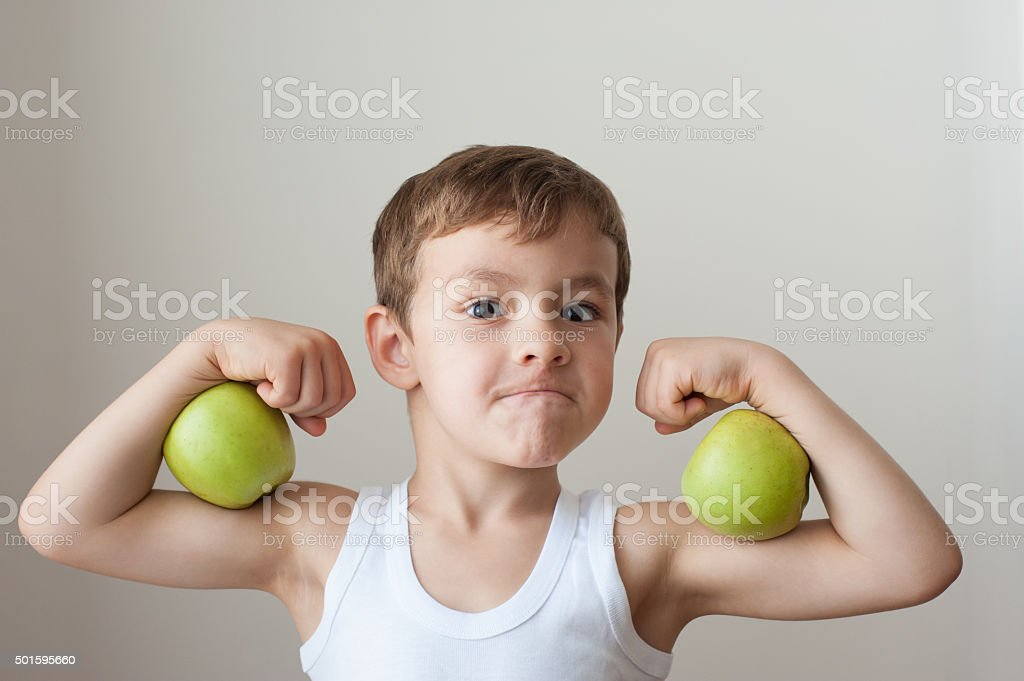 boy with apples show biceps stock photo