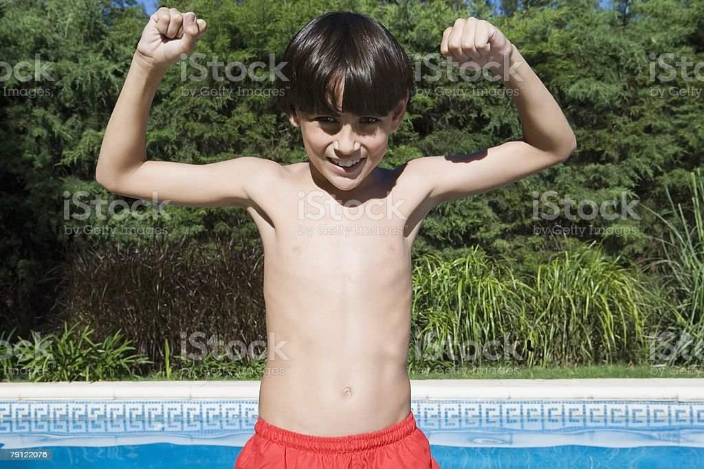 Boy with arms raised 免版稅 stock photo