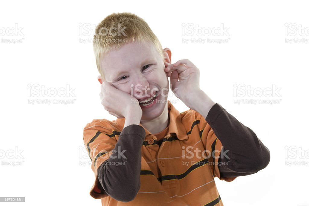 A boy with autism smiling at the camera stock photo