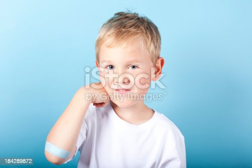 Brave little boy with band-aid on elbow.