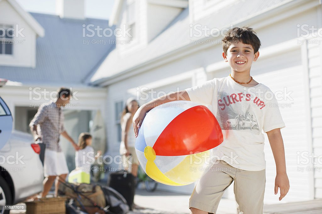 Boy with beach ball in driveway royalty-free stock photo