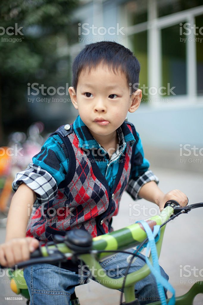 boy with bicycle stock photo