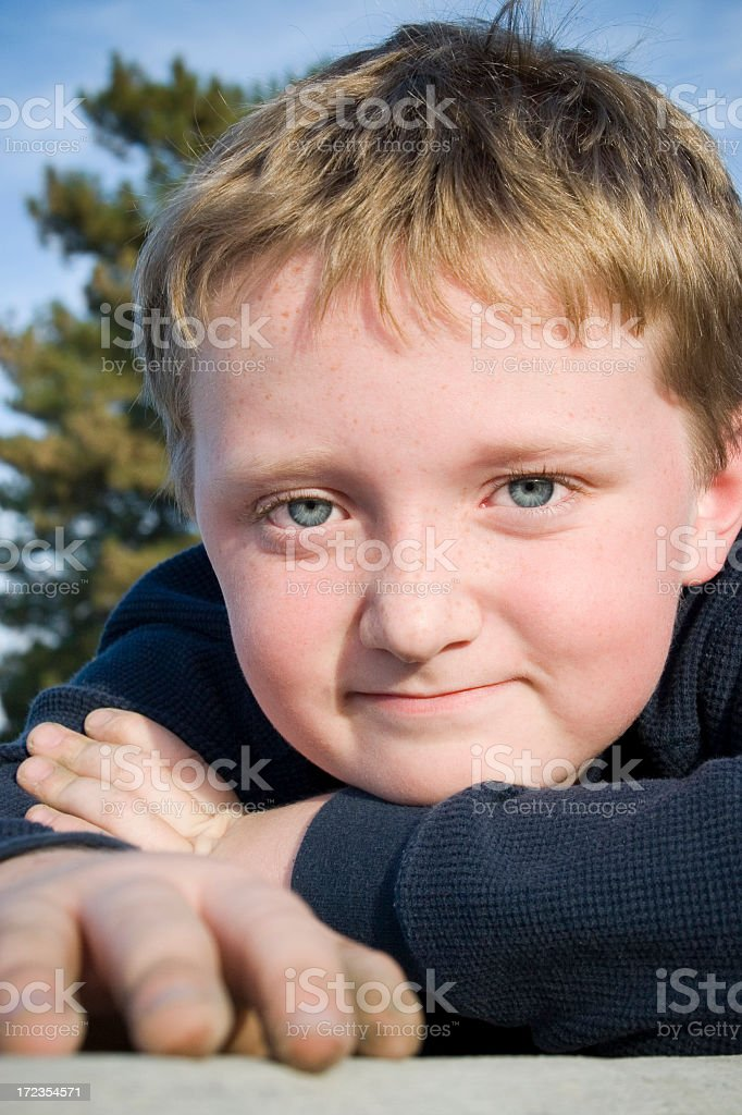 Boy with Blue Eyes and Freckles royalty-free stock photo