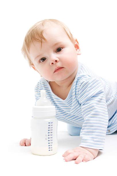 Boy with bottle of milk stock photo