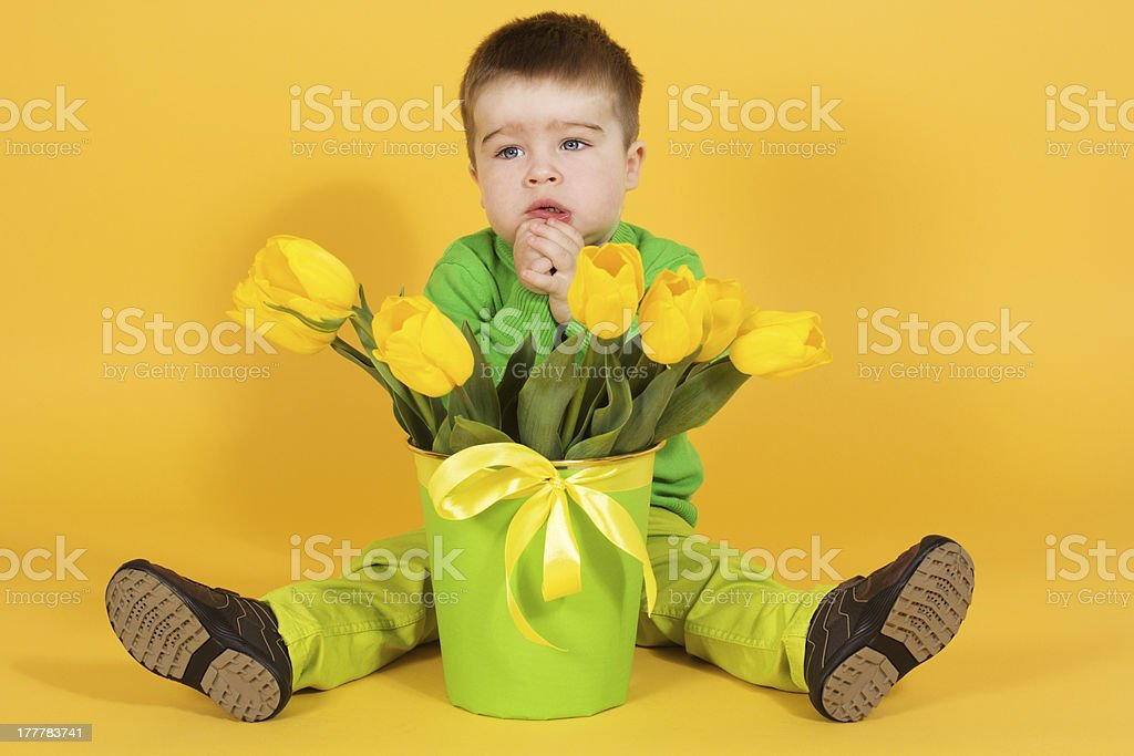 boy with bouquet of yellow tulips royalty-free stock photo